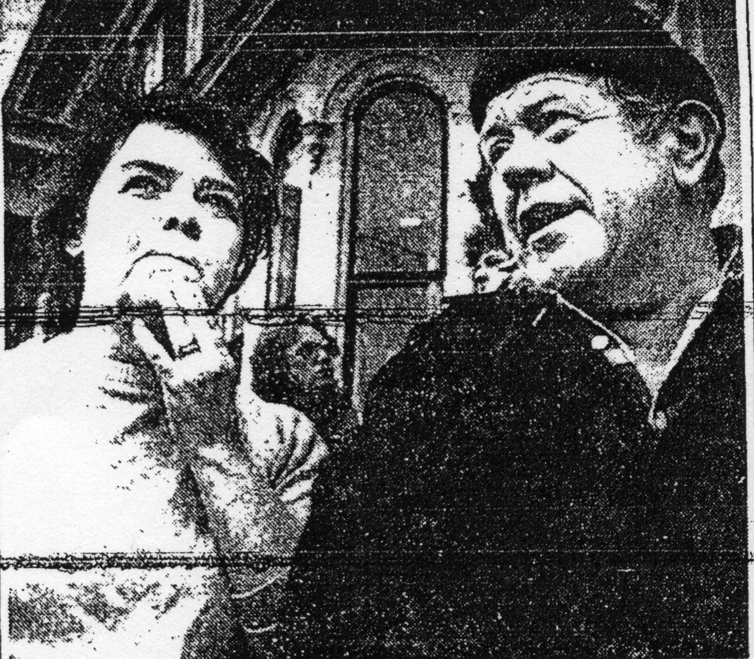 Louis and Robert Pettis look on as flames spread through their second floor apartment at 123 Congress St., in 1985. The building was their home for 24 years.