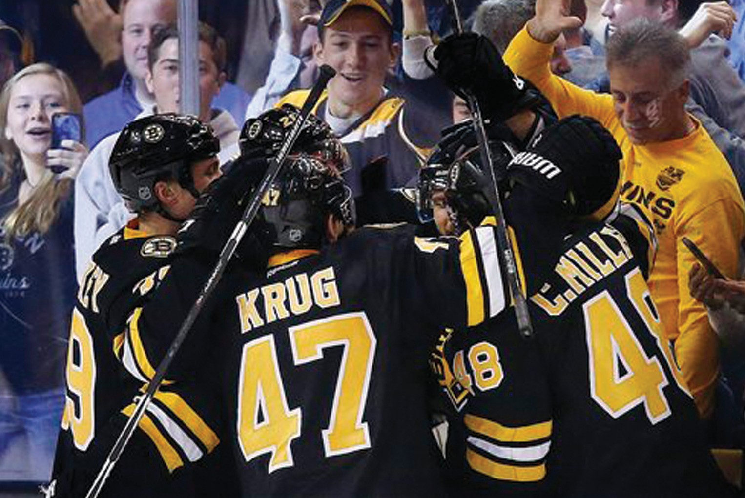 Boston Bruins' Torey Krug (47) Colin Miller (48) and teammates celebrate a go-ahead goal by David Krejci, back right, during the third period against the New York Rangers in Boston on Friday.