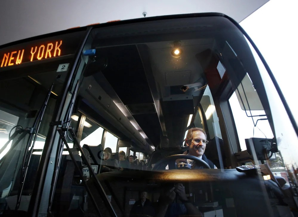 Concord Coach Lines made it first direct bus trip from Portland to New York City on Monday. Driver Roger Dubay checks his mirrors before departing from the transportation center in Portland.