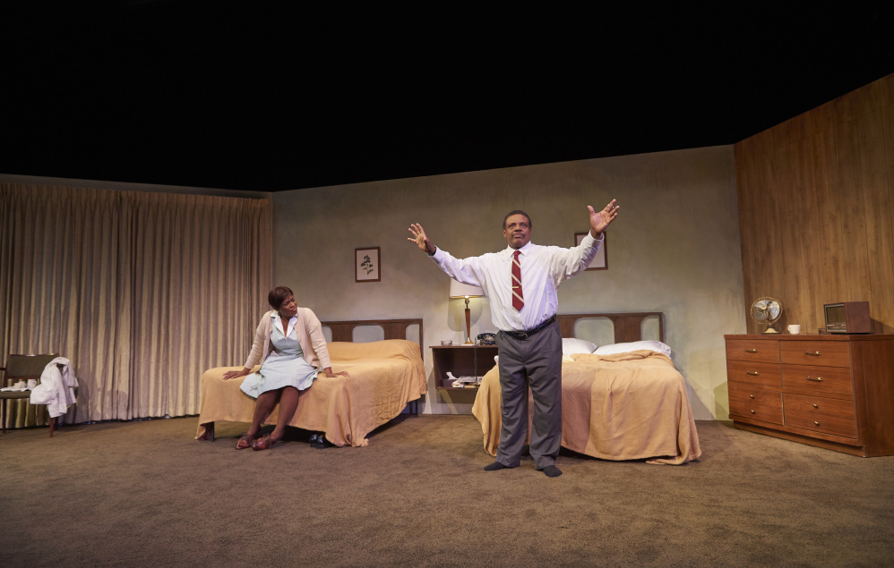 """Harvy Blanks as Dr. Martin Luther King, Jr. and Kim Staunton as Camae, a hotel maid, in Portland Stage's """"The Mountaintop."""""""