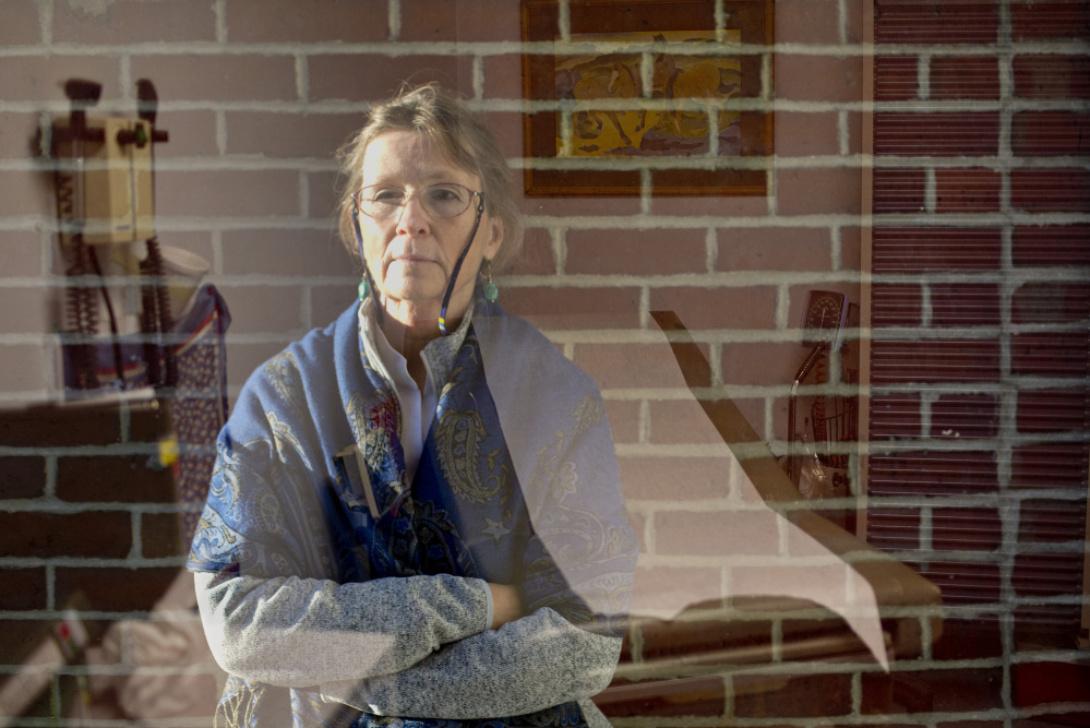 At the Milestone Foundation, primarily a short-term detox center, Dr. Mary Dowd tries to line up long-term treatment for addicts, but there are far more patients than available services. This double exposure shows her at the foundation, and in a patient exam room. Gabe Souza/Staff Photographer