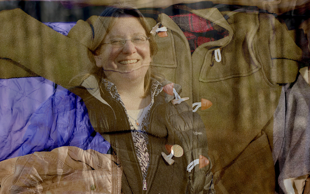 One of Jessica Maurer's projects for the Maine Association of Area Agencies on Aging is keeping seniors warm in winter by providing them with coats, like the one at L.L. Bean superimposed above. Gabe Souza/Staff Photographer
