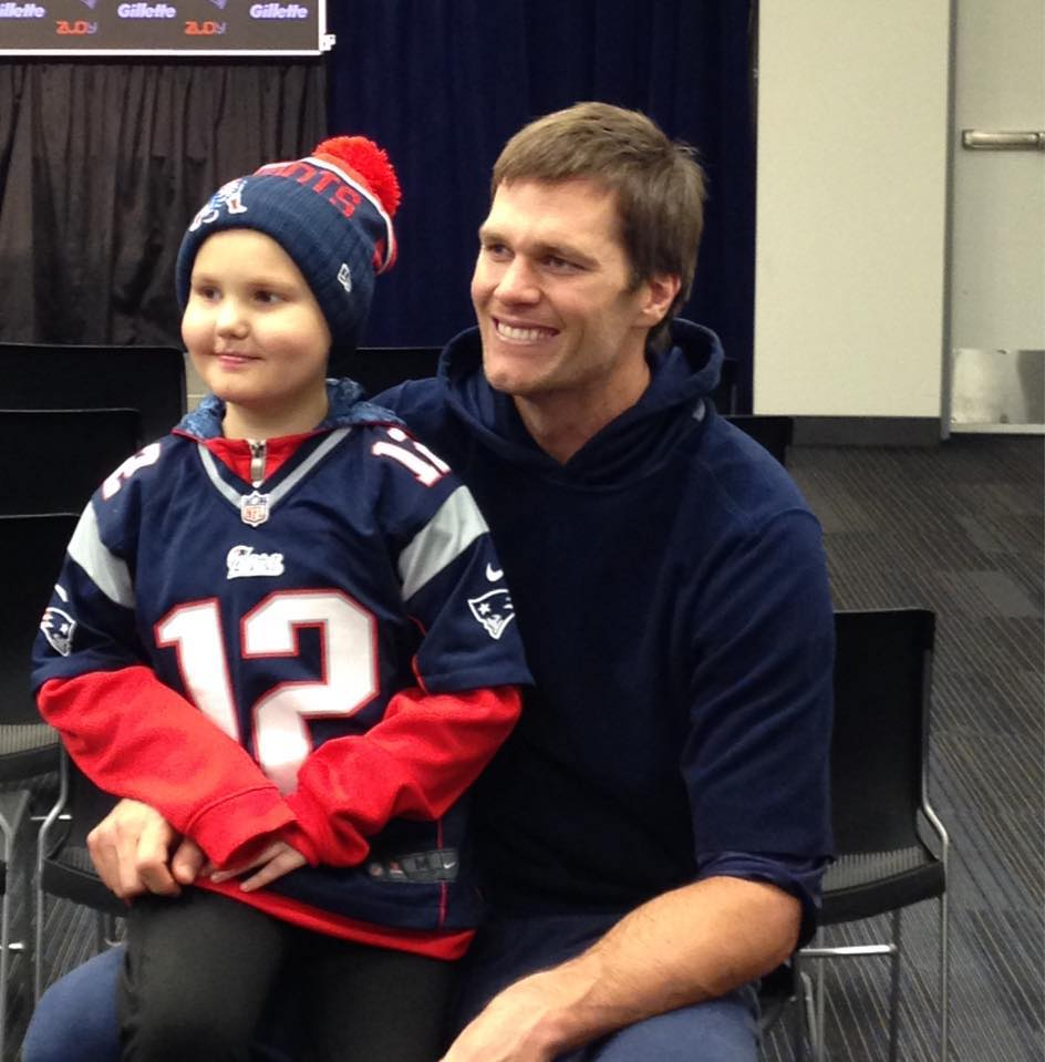 New England Patriots quarterback Tom Brady with super fan Hailey Steward of Bethel, who has leukemia. Brady invited Hailey to visit him at the team's Foxborough, Mass, headquarters after reading her story in the Portland Press Herald.