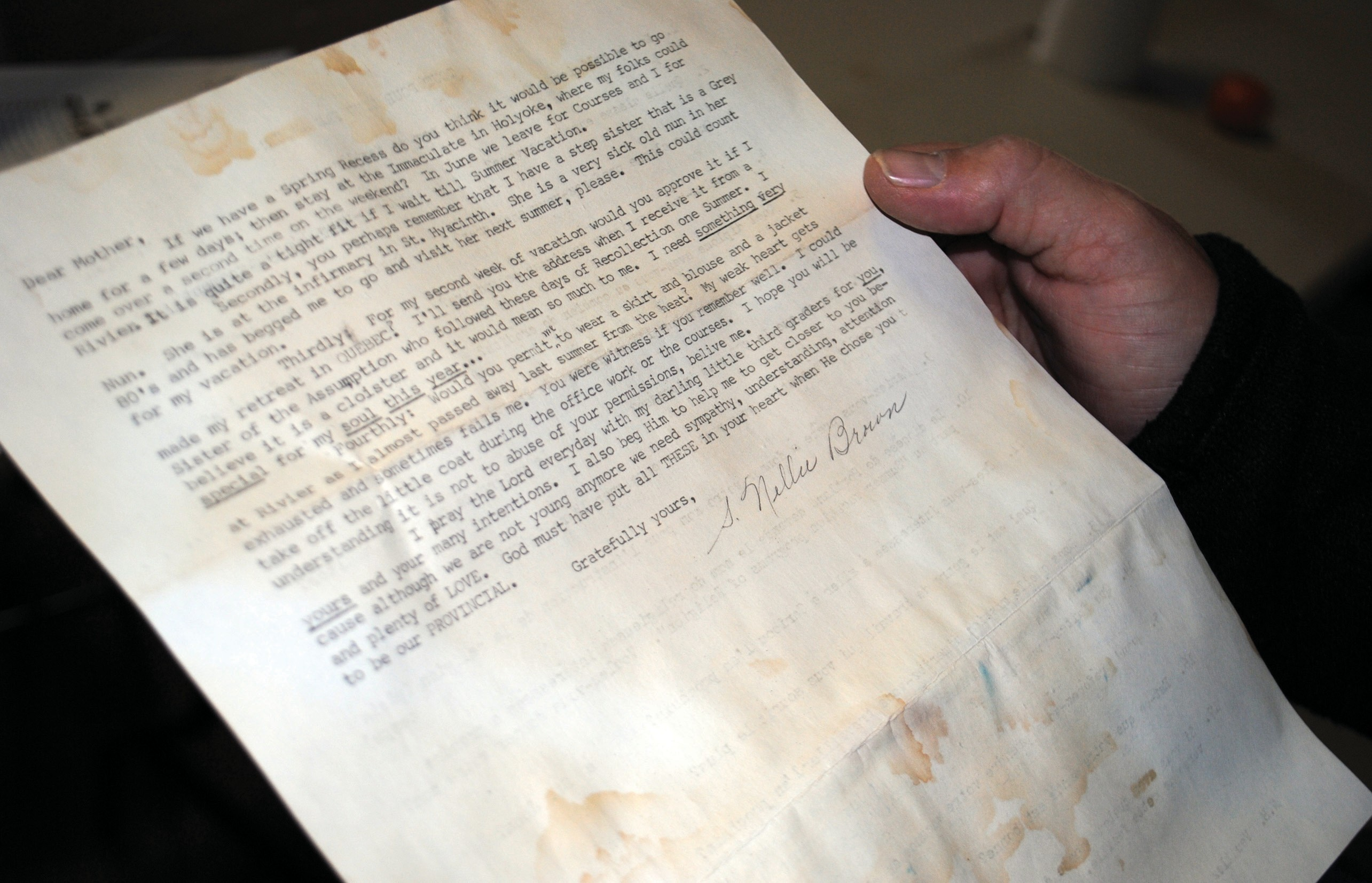 Guy Gagnon, executive director of the Biddeford Housing Authority, holds a letter discovered last week by a construction worker in the convent of the former St. Andre's Catholic Church in Biddeford. The letter is signed by Sister Nellie Brown, who taught at the school. Pictured lower right is Sister Nellie Brown.