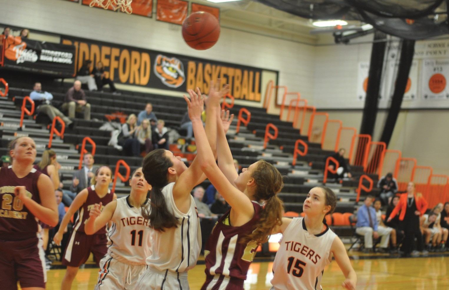 Biddeford's Taylor Wildes (left) and Thornton Academy's Lucy Macomber (right) fight for a rebound in the fourth quarter on Monday night in Biddeford.