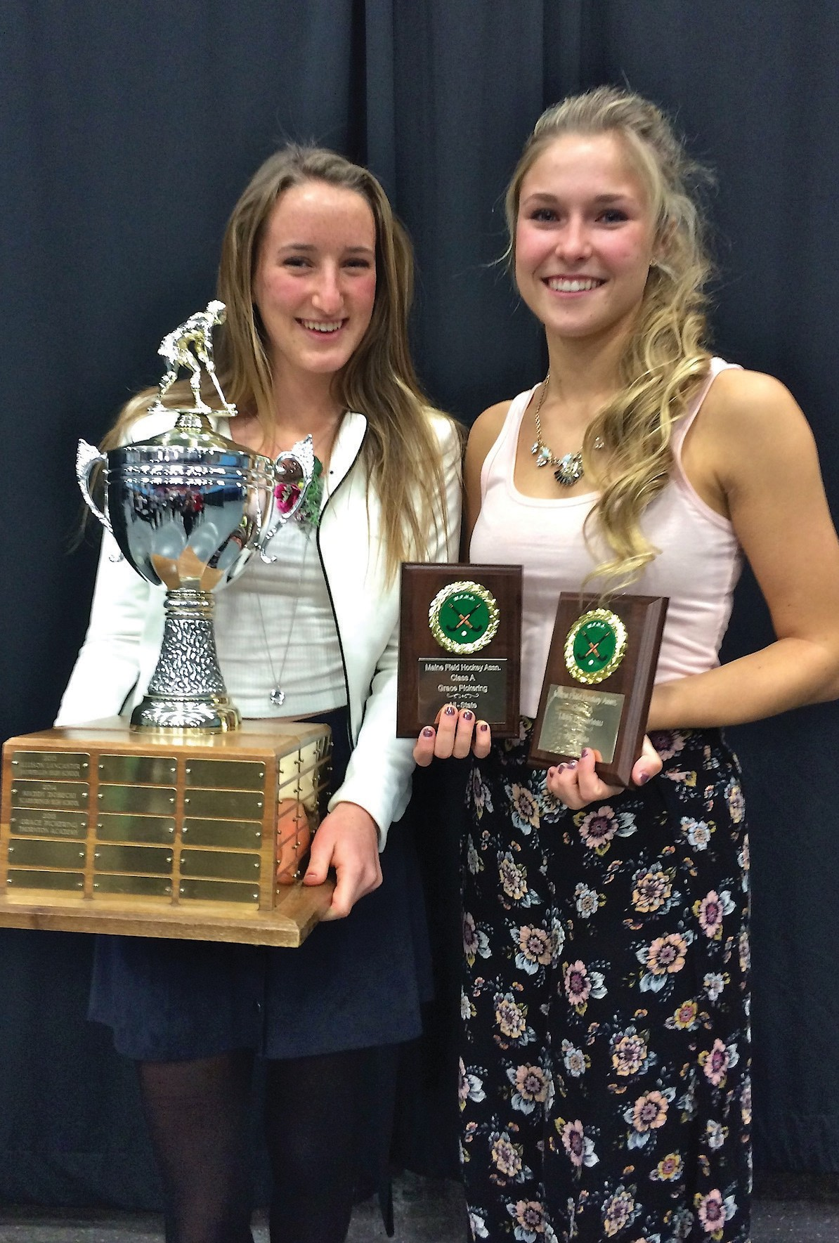 Thornton Academy's Grace Pickering (left) and Libby Pomerleau pose at the Maine Field Hockey banquet on Sunday. Pickering was named Miss Maine Field Hockey, while Pomerleau was named to the All-State team.