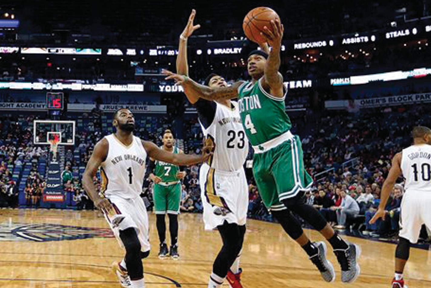 Boston Celtics guard Isaiah Thomas (4) goes to the basket against New Orleans Pelicans forward Anthony Davis (23) in the first half of in New Orleans on Monday.