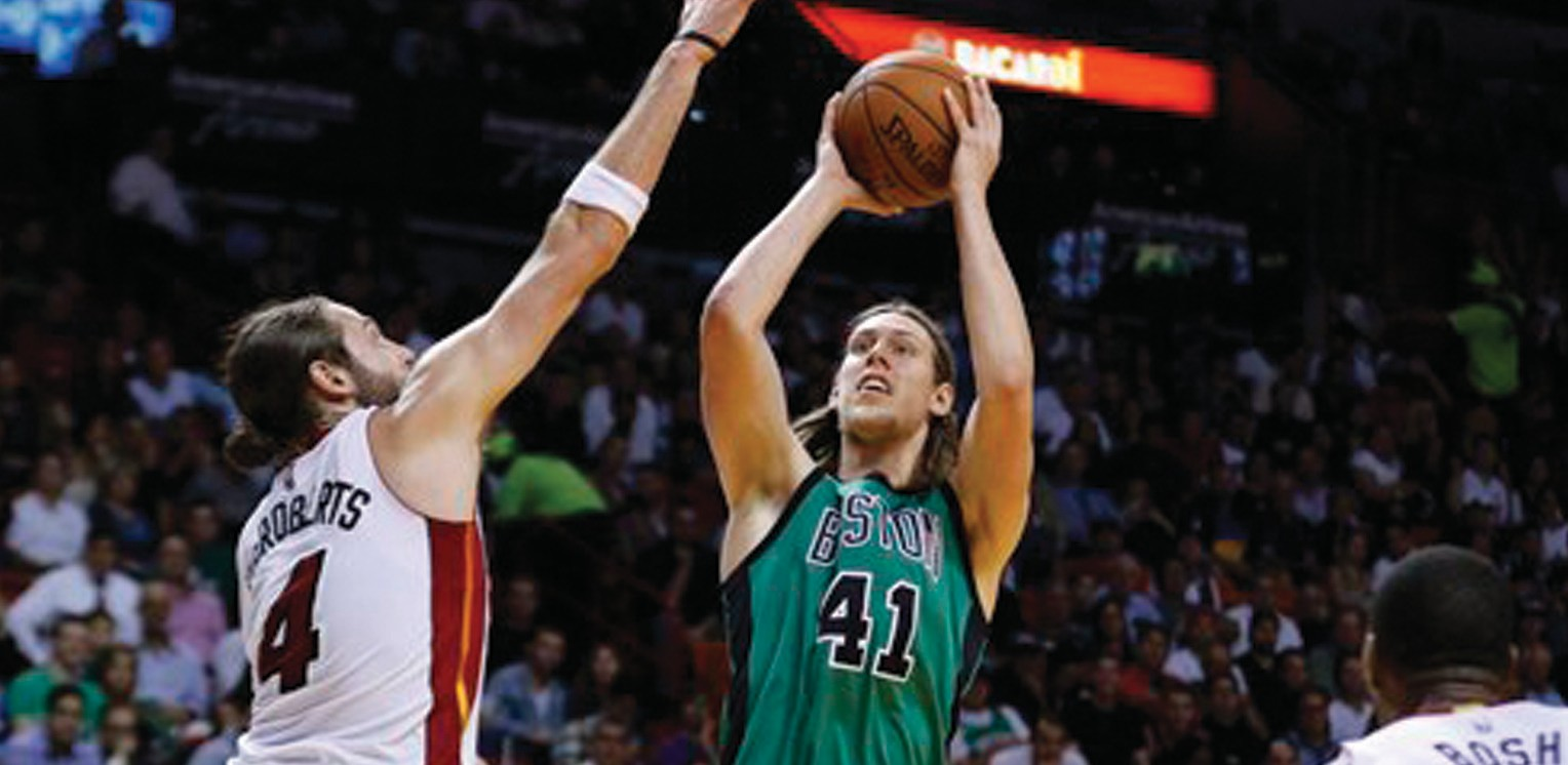 Boston Celtics center Kelly Olynyk (41) shoots as Miami Heat forward Josh McRoberts (4) defends in the second half on Monday.