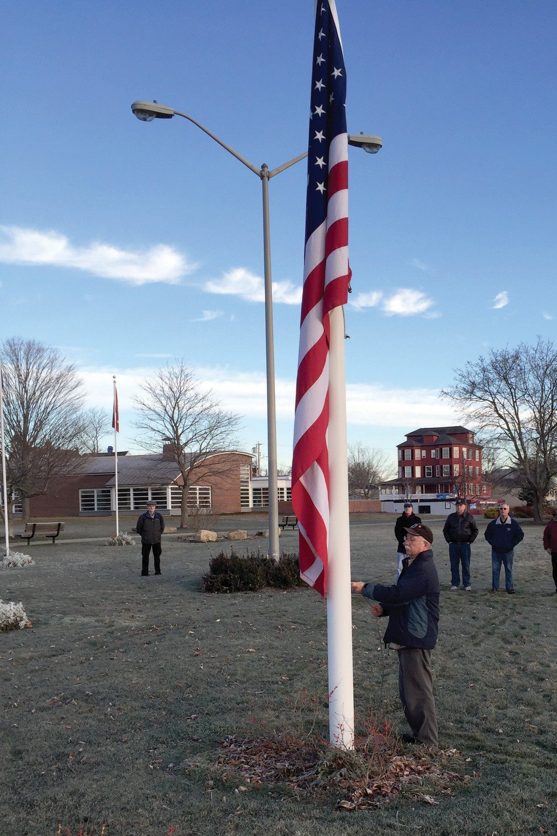 Vietnam War veteran and member of multiple veteran's organization Rich Litwin raises the American Flag Monday morning at a Pearl Harbor ceremony at Veterans Memorial Park in Old Orchard Beach.