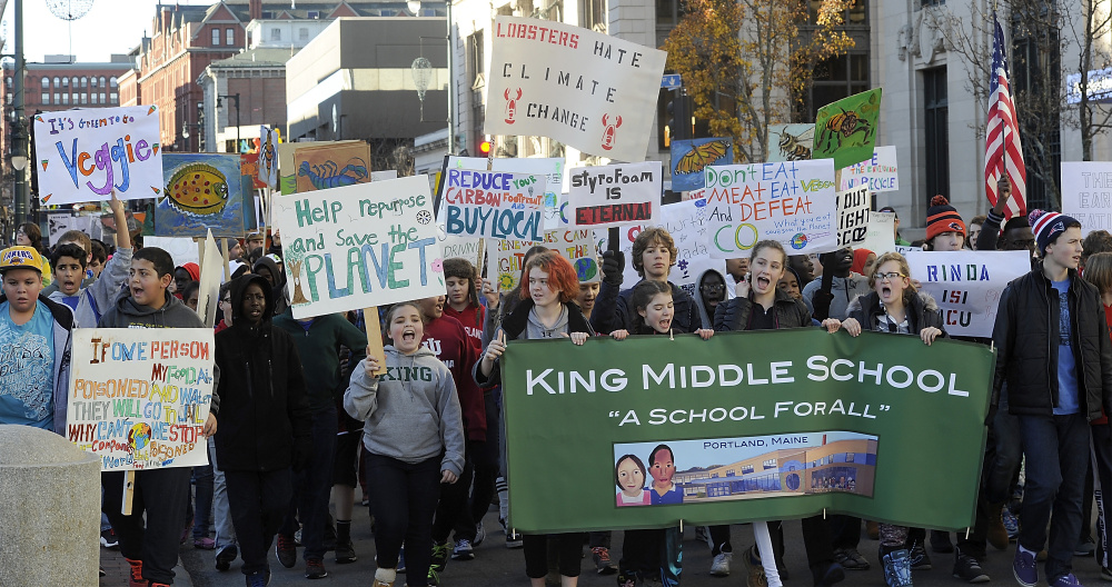 Holding posters, signs and banners, 400 students from King Middle School march to Portland City Hall to promote climate change awareness.