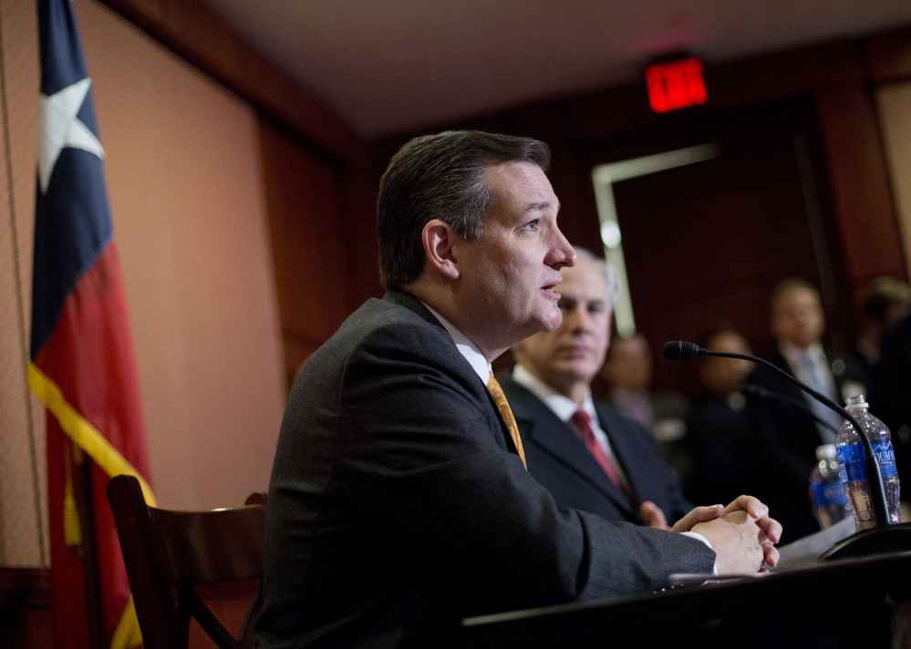 Republican presidential candidate Sen. Ted Cruz, R-Texas and Texas Gov. Greg Abbott speak about the resettlement of Syrian refugees in the U.S., during their joint news conference on Capitol Hill in Washington, Tuesday.