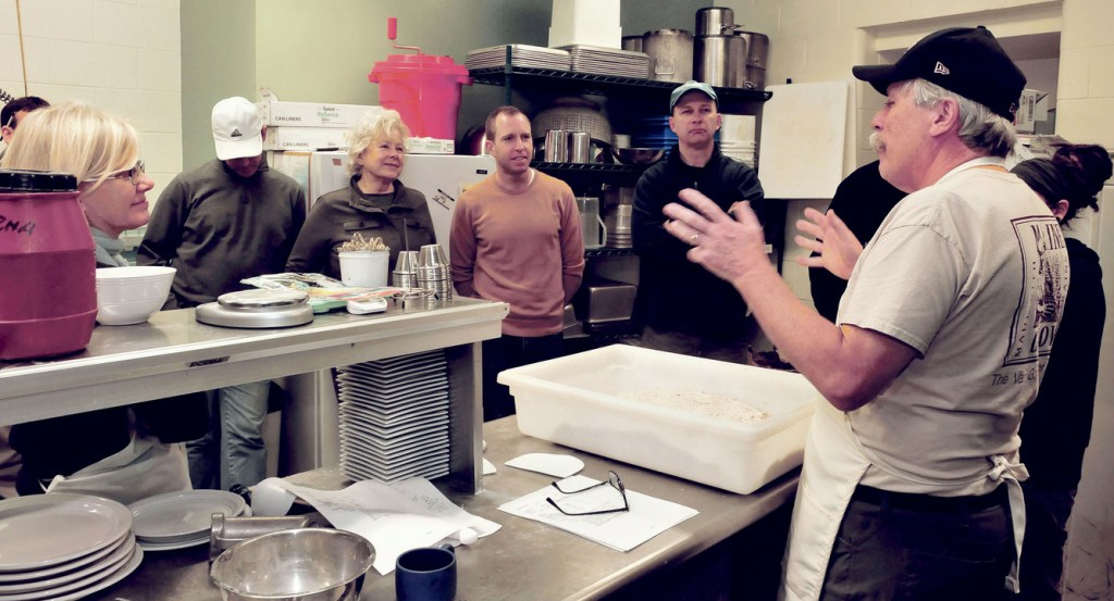 Jim Amaral, owner and founder of Borealis Breads, conducts a Maine Grain Alliance workshop on bread making to students in Skowhegan on Tuesday.