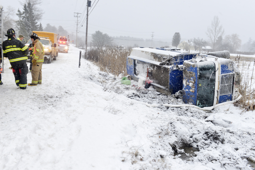 Cumberland firefighters respond to an accident on Greely Road in Cumberland after a fuel oil truck went off the road. The driver was uninjured but the truck contained about 1,700 gallons of oil that had to be pumped out before the vehicle could be pulled from the ditch.