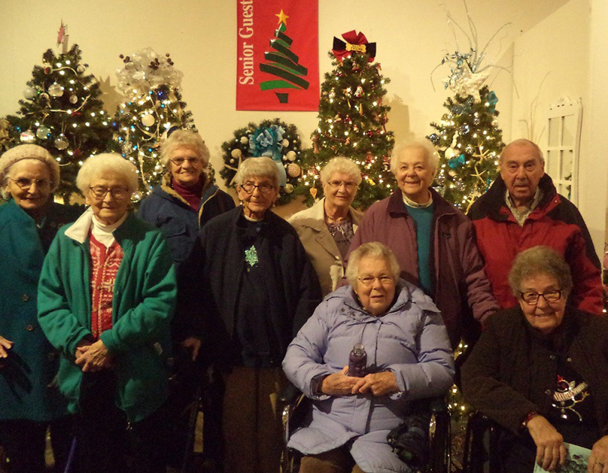 "Residents from Atria Kennebunk Lucy McDonald, Joyce Pompeo, Beverly Knight, Doris Fader, Carolynn MacDonald, Irene LeClerc, Ted Lenz, Marion Jones and Monica Lyons recently visited the Saco Museum to view the annual Festival of Tree. This year's theme is ""Home for the Holidays."""