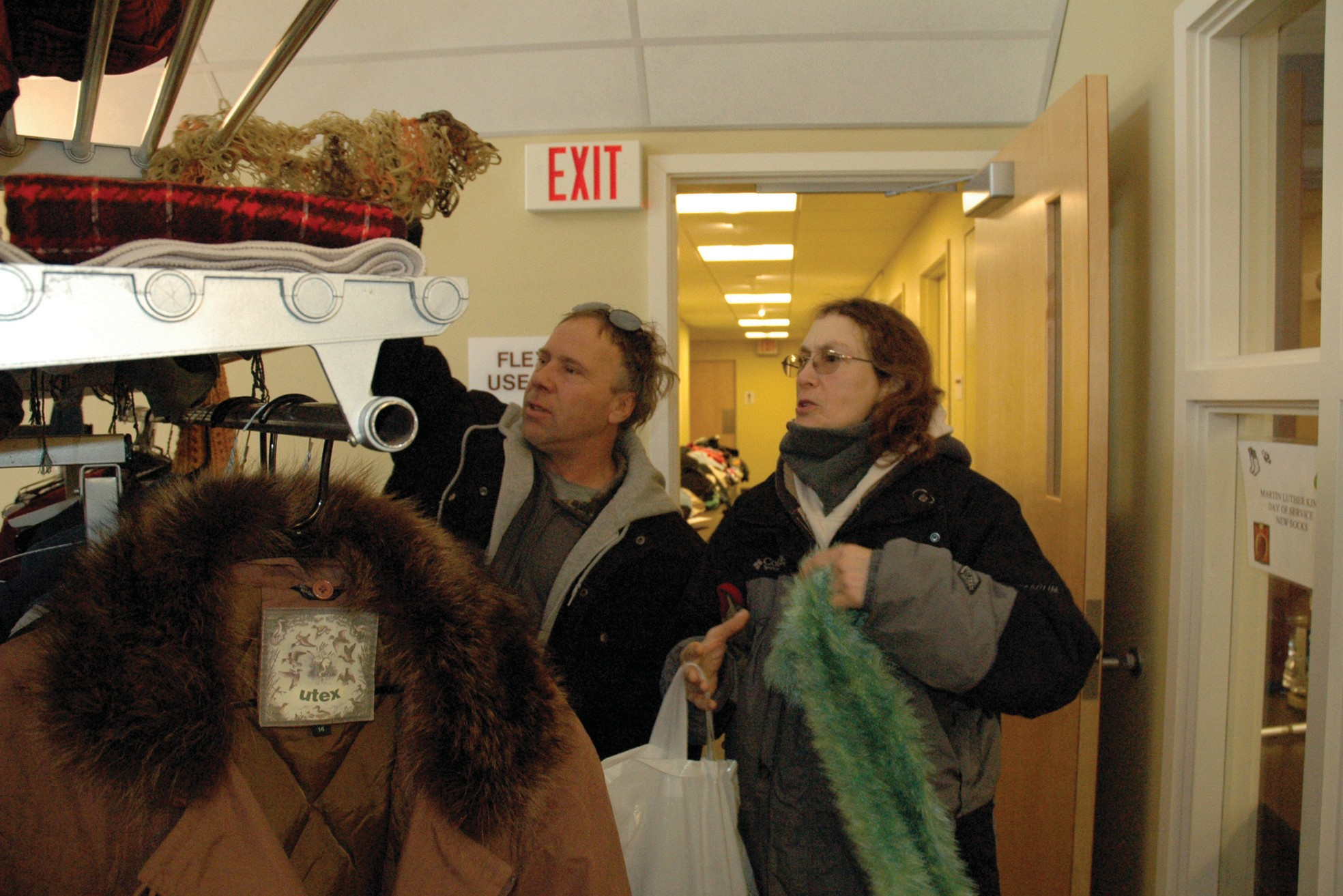 Bob and Sharon, who declined to give their last names, of Old Orchard Beach look at a rack of used clothing at First Parish Congregational Church, United Church of Christ in Saco Monday.