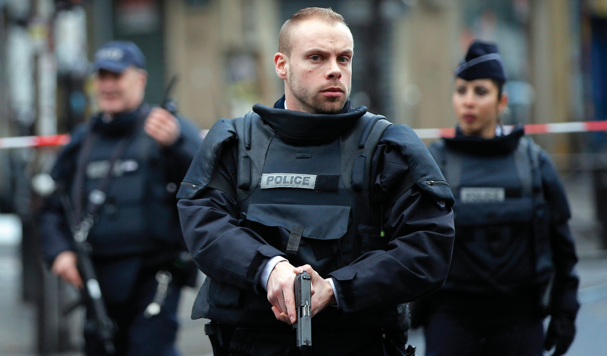 Police officers secure the perimeter near the scene of a fatal shooting which took place at a police station in Paris on Wednesday.
