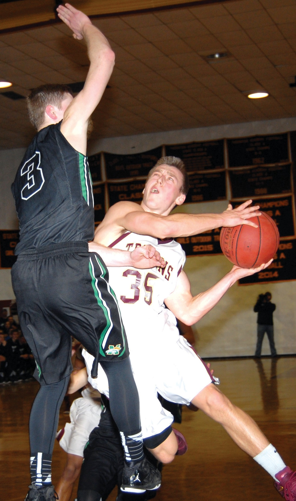 PAT MCDONALD/Journal Tribune Thornton Academy point guard Jack Tilley goes up for a shot as Massabesic's Dan Amabile defends during Thursday night's game in Saco. TA picked up a hard-fought 63-61 win.