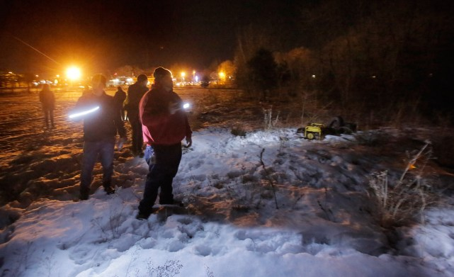 PORTLAND, MAINE - JANUARY 27, 2016: Mike Guthrie, right and Norman Maze, left, lead a group looking for homeless encampments near Forest Avenue during the annual point-in-time homeless count on Wednesday, January 27, 2016. Guthrie works for the City of Portland as a navigator for the Home to Stay program and Maze is the housing director for Shalom House. (Photo by Gregory Rec/Staff Photographer)