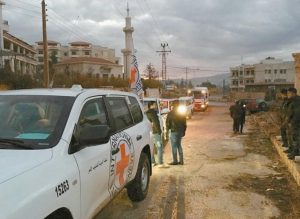 THIS PICTURE provided by The International Committee of the Red Cross, working alongside the Syrian Arab Red Crescent and the United Nations, shows a convoy containing food, medical items, blankets and other materials being delivered to the town of Madaya in Syria, Monday. The town, about 15 miles northwest of Damascus, has been blockaded for months by government troops and the Lebanese militant group Hezbollah.