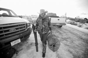 ARIZONA RANCHER LAVOY FINICUM carries his rifle after standing guard all night at the Malheur National Wildlife Refuge near Burns, Oregon, in this Jan. 6 file photo. The FBI and Oregon State Police arrested the leaders of an armed group that has occupied a national wildlife refuge for the past three weeks during a traffic stop that prompted gunfire, and one death, along a highway through the frozen high country. The Oregonian reported that Finicum was the person killed, citing the man's daughter.