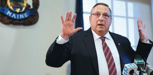 """GOV. PAUL LEPAGE speaks at a news conference last Friday in Augusta, where he apologized for his remark about out-of-state drug dealers impregnating """"young white"""" girls."""