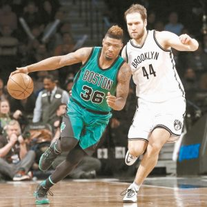 BOSTON CELTICS guard Marcus Smart (36) drives past Brooklyn Nets guard Bojan Bogdanovic (44) in the second half of an NBA basketball game on Monday in New York. The Celtics defeated the Nets, 103-94.