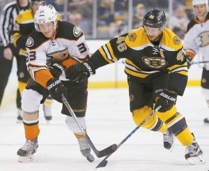 ANAHEIM'S Jakob Silfverberg (33) and Boston Bruins' David Krejci (46) battle for the puck during the first period of an NHL hockey game in Boston on Tuesday.