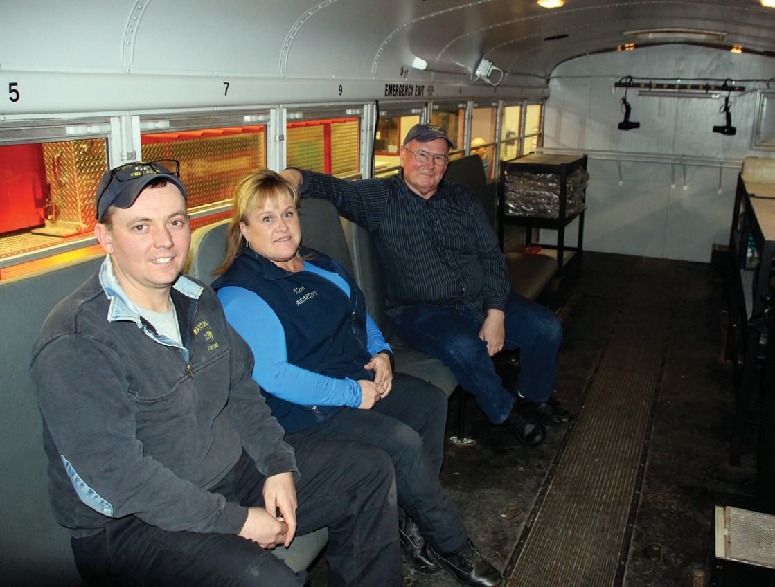From left, Waterboro Fire Department Lt. Mike Fraser, firefighter Kerri Stearns and Lt. John Cloonan take a seat inside a converted school bus that now serves as a rehab unit.