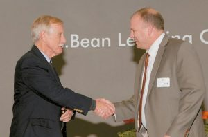 BRUNSWICK POLICE CMDR. MARK WALTZ, right, is congratulated by Sen. Angus King (I-Maine), for receiving the Citizen of the Year award from the Southern Midcoast Maine Chamber of Commerce at a recent ceremony.