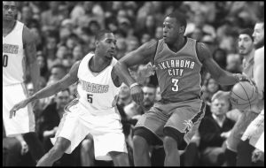 OKLAHOMA CITY THUNDER guard Dion Waiters, right, tries to work the ball inside as Denver Nuggets forward Will Barton defends during the second half of an NBA basketball game on Tuesday in Denver. The Thunder won, 110-104