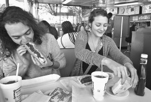 TRAVIS RUDDOCK, left, and Samantha Murray dig into footlongs at Kermit's Hot Dog House in Winston-Salem, N.C. Murray, who grew up nearby and visited Kermit's on weekends when her father drove in the demolition derby at Bowman Gray Stadium, brought Ruddock for his first taste of the iconic landmark's specialty.