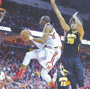 MARYLAND'S Rasheed Sulaimon drives to the basket around Iowa's Dom Uhl in the second half of an NCAA college basketball game on Thursday in College Park, Md. Maryland won, 74-68.