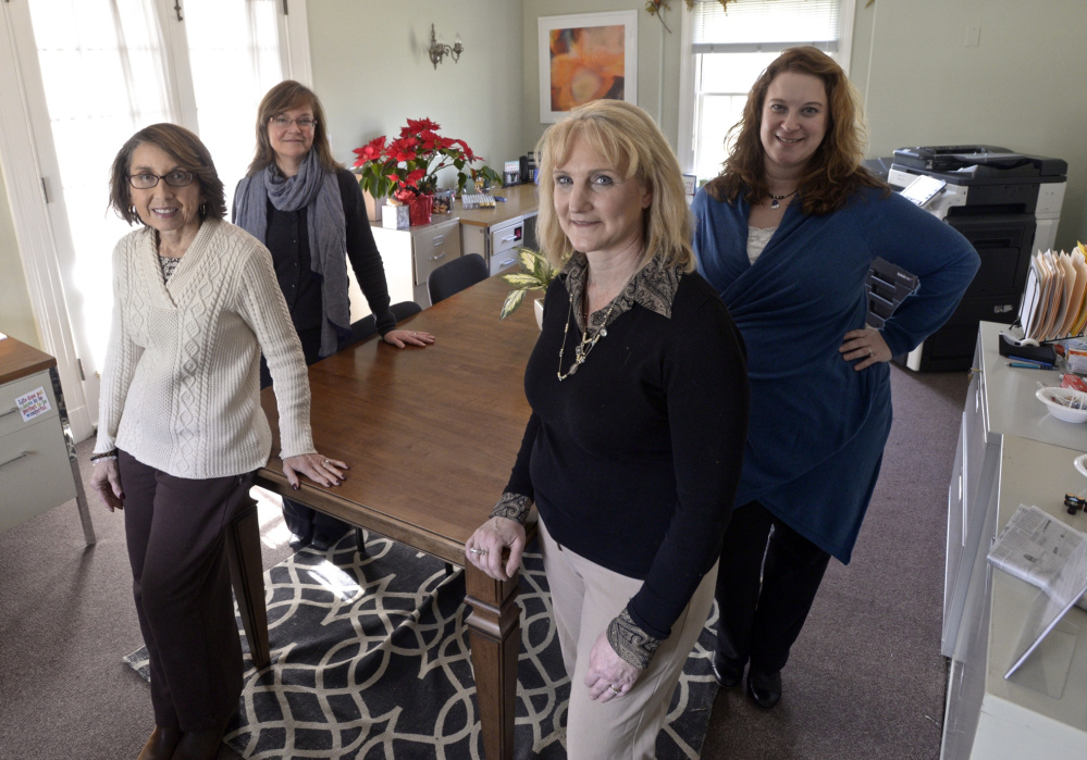 Deb DelVecchio-Scully, front left, Melissa Glaser, front right, Catherine Galda, back left and Margot Robins are working on a long-term plan for Newtown, Conn., after a federally funded trauma team that helped people deal with the Sandy Hook shootings wraps up its work.
