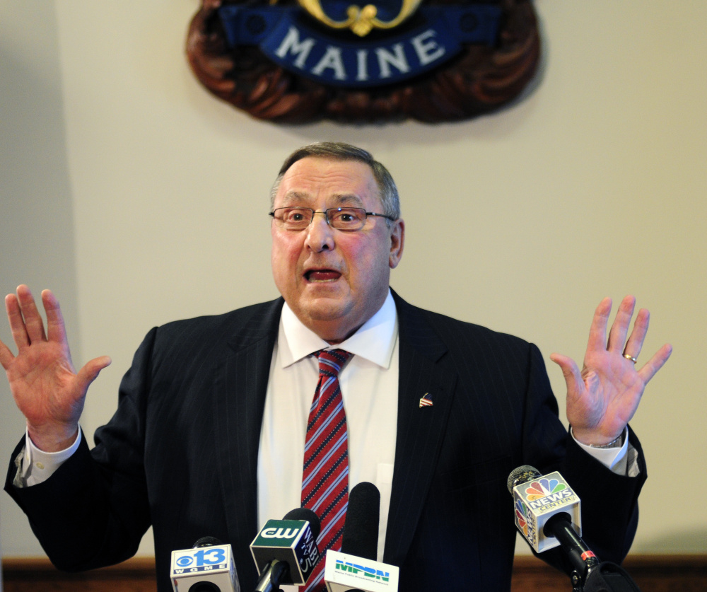 """Maine Gov. Paul LePage speaks Friday in the State House cabinet room in Augusta. He said he wasn't """"smart enough"""" to deliberately tap old racial tensions about black men and white women, instead shifting the blame toward his critics and the media. (Joe Phelan/Kennebec Journal)"""