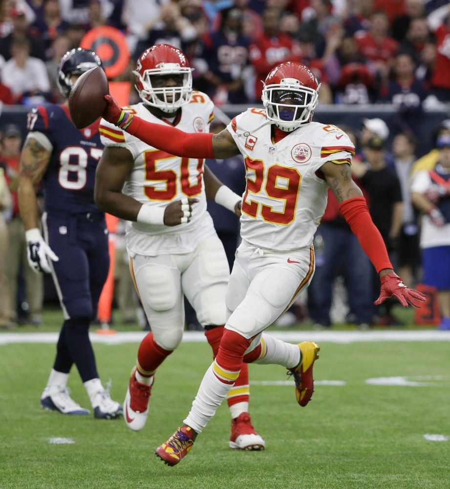 Kansas City Chiefs free safety Eric Berry, right, celebrates his interception against the Texans during a 30-0 wild-card win Saturday at Houston. The Chiefs, who had just six interceptions last season, rang up 22 this year.