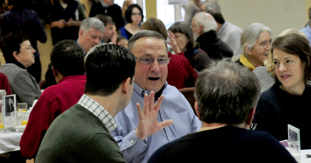 Gov. Paul LePage speaks with Waterville Mayor Nick Isgro and Sharon Corwin on Monday during the 30th annual Martin Luther King Jr. breakfast event at the Muskie Center in Waterville.
