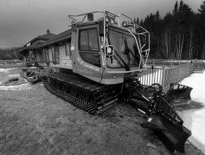 A TRAIL GROOMER used by the Twin Mountain Snowmobile club sits idle on the grass Wednesday in Twin Mountain, New Hampshipre. A drop in snowmobile registration and club membership jeopardizes money that clubs hope to get in future years.