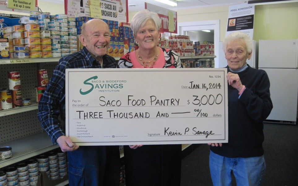 Bob Nichols, Saco Food Pantry director; Lynne Belanger, Saco branch manager of SBSI; and Alice Finnegan, Saco Food Pantry chairperson.