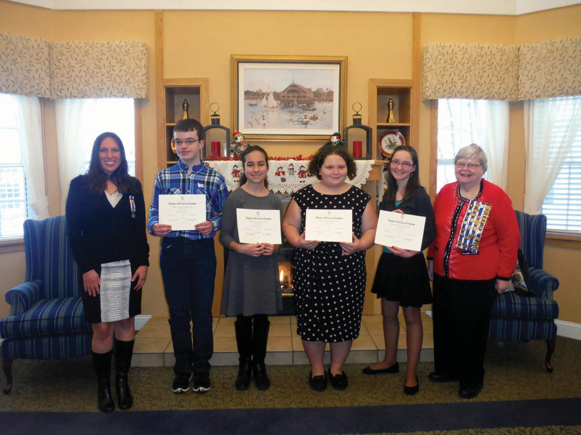 Pictured from left are Rebecca Emery Chapter Historian of the Daughters of the American Revolution Leigh Rush Olson; Jeffrey Fosgatem, Sarah Bouley and Emily Ireland, all of Massabesic Middle School; Sophia Tanguay of Waterboro Elementary School; and Chapter Regent Helen Newton.