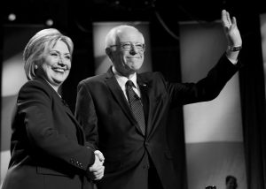 DEMOCRATIC PRESIDENTIAL CANDIDATES Hillary Clinton, left, and Sen. Bernie Sanders, I-Vt, pose for a photo before debating at the University of New Hampshire Thursday in Durham, N.H.