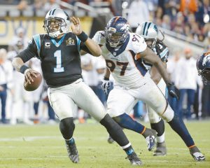 DENVER BRONCOS defensive lineman Malik Jackson (97) chases Carolina Panthers Cam Newton (1) during the second half of the NFL Super Bowl 50 football game on Sunday in Santa Clara, Calif. The Broncos defeated the Panthers, 24-10.