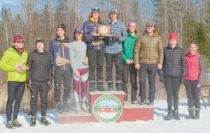 THE FREEPORT HIGH SCHOOL boys Nordic team stands atop the podium after winning the State Class B Championship recently at Titcomb Mountain in Farmington. See complete details of the high school ski championships on B2 and B3.