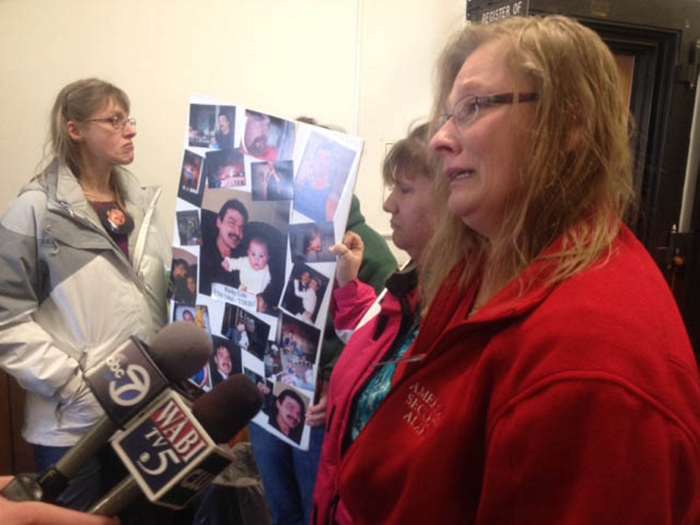 Sisters of murder victim Ricky Cole talk to reporters Friday outside the courtroom where Jason Cote was sentenced to 45 years in prison. The sisters are Annette Thibodeau, foreground, and Carmen Stanton, back.