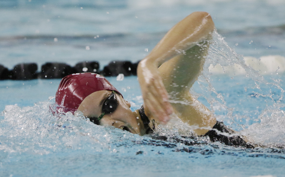 Olivia Tighe, a freshman from Cape Elizabeth, swims the 200-yard freestyle Monday during the state finals in Brunswick. Tighe won the race with a time of 1:55.48.