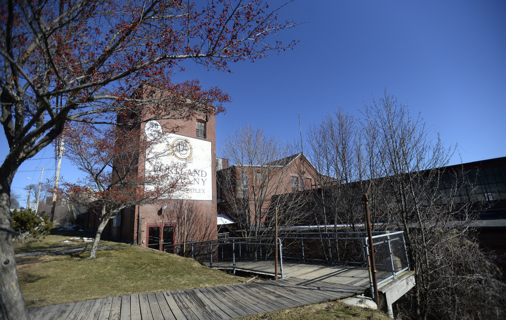 Preservationists wanted the former machine erecting shop at the Portland Co. complex to be saved and repaired, while the city's Planning Board and development community supported demolishing it as part of a redevelopment project. Shawn Patrick Ouellette/Staff Photographer