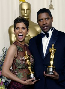 """Halle Berry and Denzel Washington celebrate their best actress and actor Oscars for, respectively, """"Monster's Ball"""" and """"Training Day"""" at the 2002 Academy Awards."""