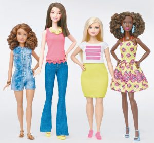 THIS PHOTO provided by Mattel shows a group of new Barbie dolls introduced in January 2016. Mattel, the maker of the famous plastic doll, said it will start selling Barbie's in three new body types: tall, curvy and petite. She'll also come in seven skin tones, 22 eye colors and 24 hairstyles.