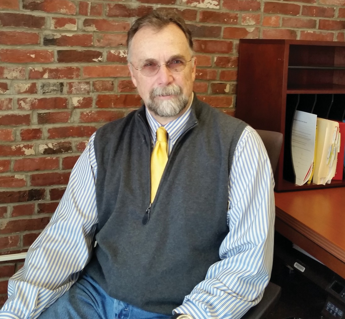 Neighbor Robert Biggs, the new executive director for Saco Main Street, in his Saco office.