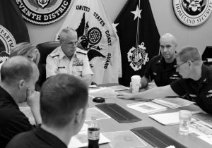 REAR ADM. SCOTT BUSCHMAN, commander of the Coast Guard 7th District, receives an update brief for the missing cargo ship El Faro at the Coast Guard 7th District in Miami in this October 2015 file photo. A series of U.S. Coast Guard hearings starting today will seek answers about why the freighter El Faro sank near the Bahamas last fall, killing all crew members in the worst U.S. commercial maritime disaster in decades.