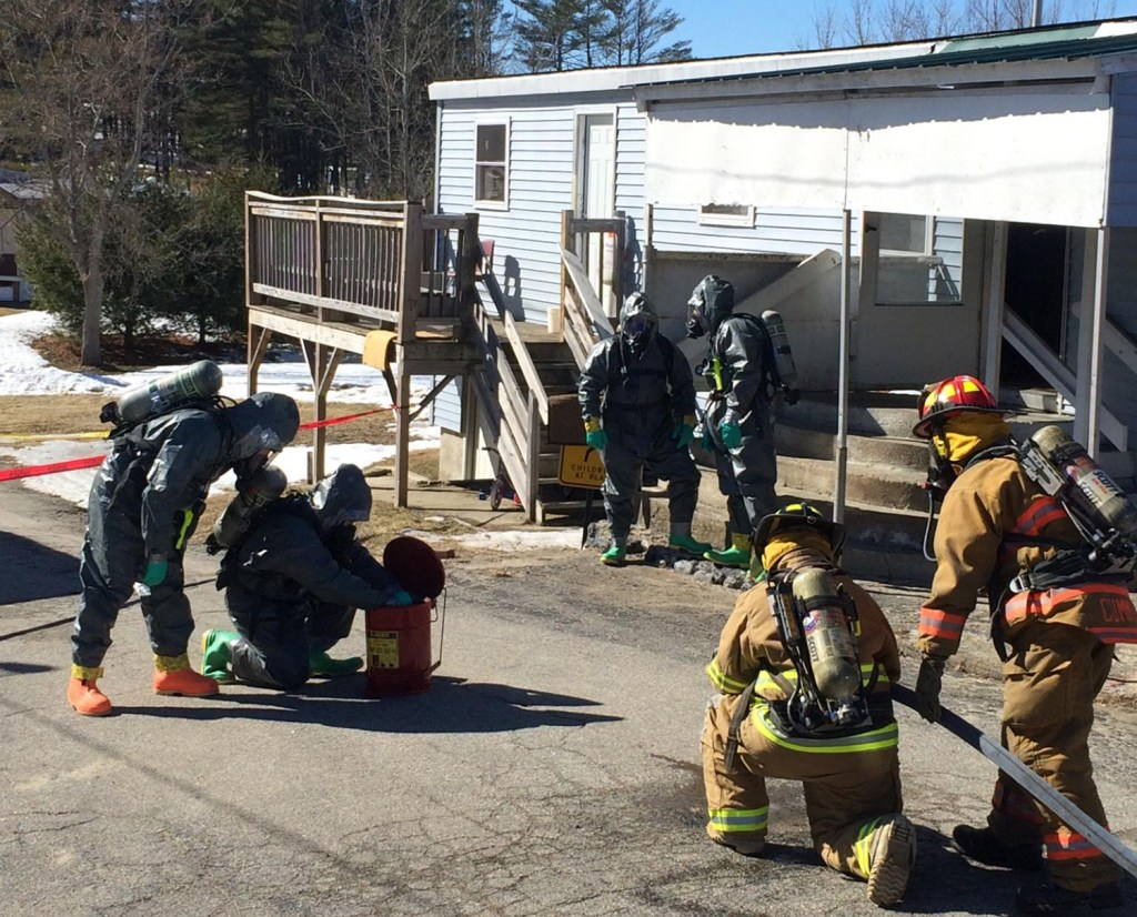 Police and firefighters prepare to enter a suspected meth lab in Livermore Falls. Courtesy Photo